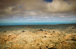 Volcanic landscape and the sea Stock Photography