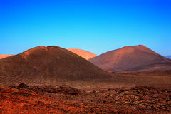 Volcanic landscape, Timanfaya National Park. Volcanic landscape, Timanfaya National Park, Island Lanzarote, Canary Islands, Spain Stock Images