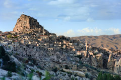 Volcanic landscape of Uchisar. Old hilly town Uchisar with it's Citadel and houses built around. Goreme region / Turkey / Cappadocia Stock Photos
