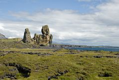 Volcanic landscape in West Iceland. High rocks in the middle of lava field Stock Photo
