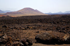 volcanic  lanzarote  spain  timanfaya  rock  sky  hill and summe Royalty Free Stock Images
