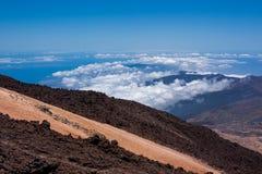 Volcanic lava landscape above the clouds Stock Photos