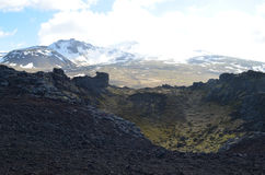 Volcanic Lava Rock and Mountains in Iceland Royalty Free Stock Photography