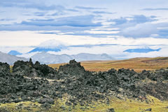 Volcanic lava. Weathering of volcanic lava at the foot of the Gorely volcano, Far east, Russia, Kamchatka Royalty Free Stock Photo