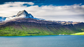 Volcanic mountain over fjord, Iceland Royalty Free Stock Photo