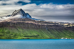 Volcanic mountain over fjord Royalty Free Stock Images