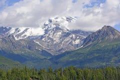 Volcanic Mountain Peeking Through the Clouds Royalty Free Stock Photo