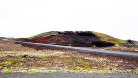 Volcanic mountain with red colours at Myvatn lake Stock Photo