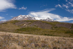 Volcanic mountain with summit covered by snow. Active volcano Ruapehu in Tangoriro National Park, New Zealand royalty free stock photo
