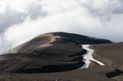 Volcanic mountains above the clouds royalty free stock photos