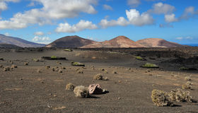 Volcanic mountains at Lanzarote Island, Canary Islands, Spain Royalty Free Stock Images