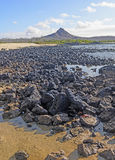 Volcanic Peak on a Remote Island Shore Stock Photos