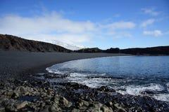 Volcanic pebble beach Stock Photography