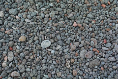 Volcanic pebbles. An array of volcanic pebbles on beach Stock Images