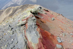 Volcanic red frozen lava, ash and sand on mountain range. Volcano crater red lava rocks,a ash and sand on mountain range. Ancient volcano crater from inside Royalty Free Stock Photos