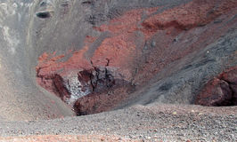 Volcanic red lava rocks in crater Stock Photos