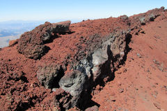 Volcanic red lava rocks in crater royalty free stock image