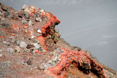 Volcanic red lava rocks in crater stock image