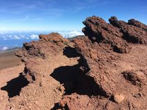 Volcanic red rocks jutting out of the mountain at Haleakala National Park royalty free stock photos