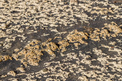 Volcanic rock and black sand closeup Royalty Free Stock Photo