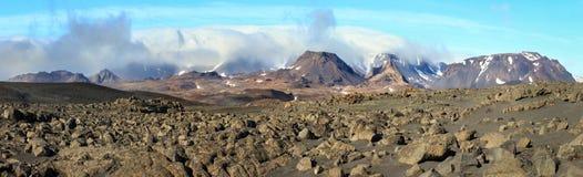 Volcanic rock desert and mountains of Porisjokull. Iceland near Kaldidalur. royalty free stock photography