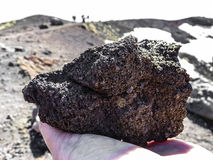 Volcanic rock in human hand at mount Etna, Sicily. Stock Photo