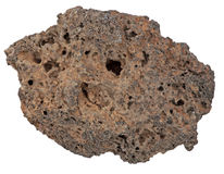 Volcanic Rock from Kenya. A volcanic (basalt) rock from the Great Rift Valley in Kenya. This rock shows signs of the gas that bubbled through the magma when the Stock Photo