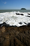 Volcanic rock by sea Stock Photography