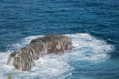 The Volcanic Rock and the Waves Stock Photography