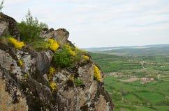 Volcanic rocks above village Royalty Free Stock Photo
