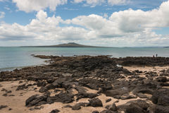 Volcanic rocks on beach in Takapuna Royalty Free Stock Photography