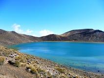 New zealand tongariro crossing national park volcano blue lake. Volcanic rocks blue lake and a sunny day to hike. 19 km hiking in tongariro alpine crossing stock image