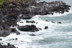 Volcanic rocks  at a coast of Jeju Island. Stock Image