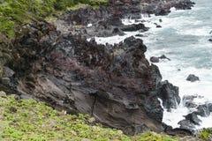 Volcanic rocks  at a coast of Jeju Island. Stock Images
