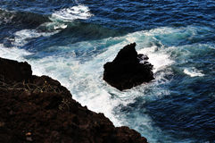 Volcanic Rocks in ocean Royalty Free Stock Images