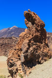 Volcanic rock and volcano. Volcanic rocks and volcano from a distance Stock Photos