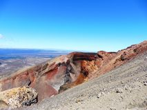 New zealand tongariro crossing national park volcano, red crater. Volcanic rocks red crater and a sunny day to hike. 19 km hiking in tongariro alpine crossing royalty free stock images