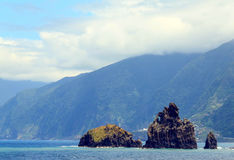 The volcanic rocks. The volcanic rock in the ocean. Island Madeira stock photo
