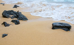 Volcanic rocks on the sands of Maui, Hawaii Royalty Free Stock Image