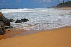 Volcanic rocks on Sunset Beach Royalty Free Stock Image