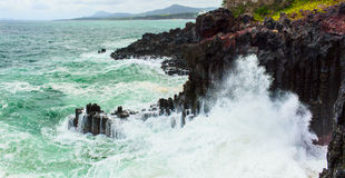 Volcanic rocky coast with storming sea. South Korea Royalty Free Stock Photos