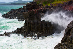 Volcanic rocky coast with storming sea. South Korea Stock Photography
