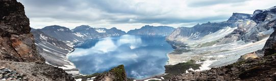 Volcanic rocky mountains and lake Tianchi, Changbaishan, China Royalty Free Stock Images