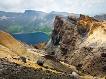 Volcanic rocky mountains, wild landscape. Volcanic rocky mountains and lake Tianchi, wild landscape, national park Changbaishan, China royalty free stock photography