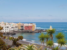 Volcanic sand beach and harbour of Tenerife. Volcanic sand beach and harbour viewed from park Royalty Free Stock Photo
