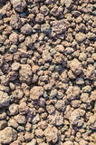 Volcanic slag at the foot of a volcano Royalty Free Stock Photos