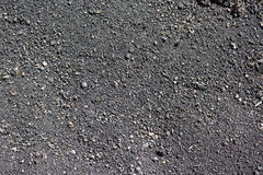 Volcanic small gravel backgrounds Caldera de los Cuervos on Lanzarote. Stone chippings background of the volcanic rock, Timanfaya National Park stock photos