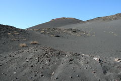 Volcanic soil and sky on the top of Etna Mountain Stock Photos