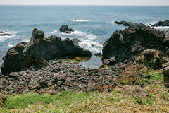 Volcanic Stone Bay at Seopjikoji. Jeju, South Korea. Volcanic Stone Bay. Seopjikoji is located at the end of the eastern shore of Jeju Island. Seopji is the old Stock Photography
