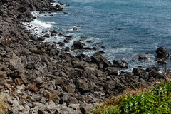 Volcanic Stone Bay at Seopjikoji. Jeju, South Korea. Volcanic Stone Bay. Seopjikoji is located at the end of the eastern shore of Jeju Island. Seopji is the old Royalty Free Stock Image